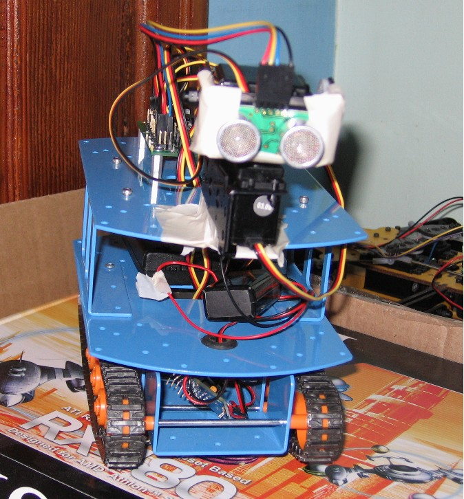 Two-tiered tracked robot with Ultrasonic sensor eyes