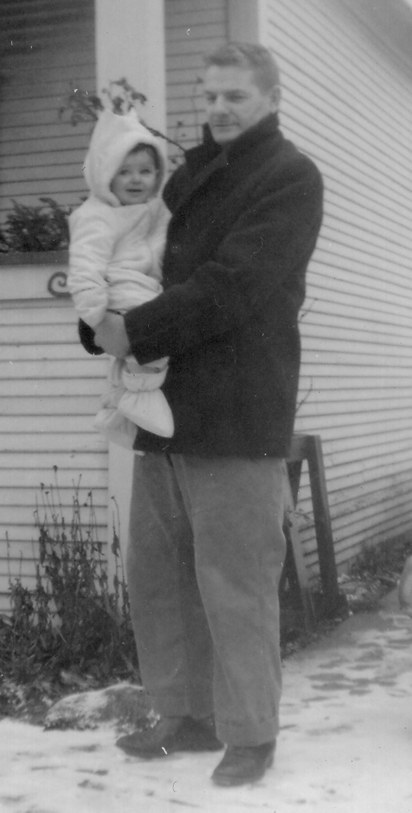 Ernie Frazer holding daughter Karen, in the driveway of their Audley St home in Victoria, BC