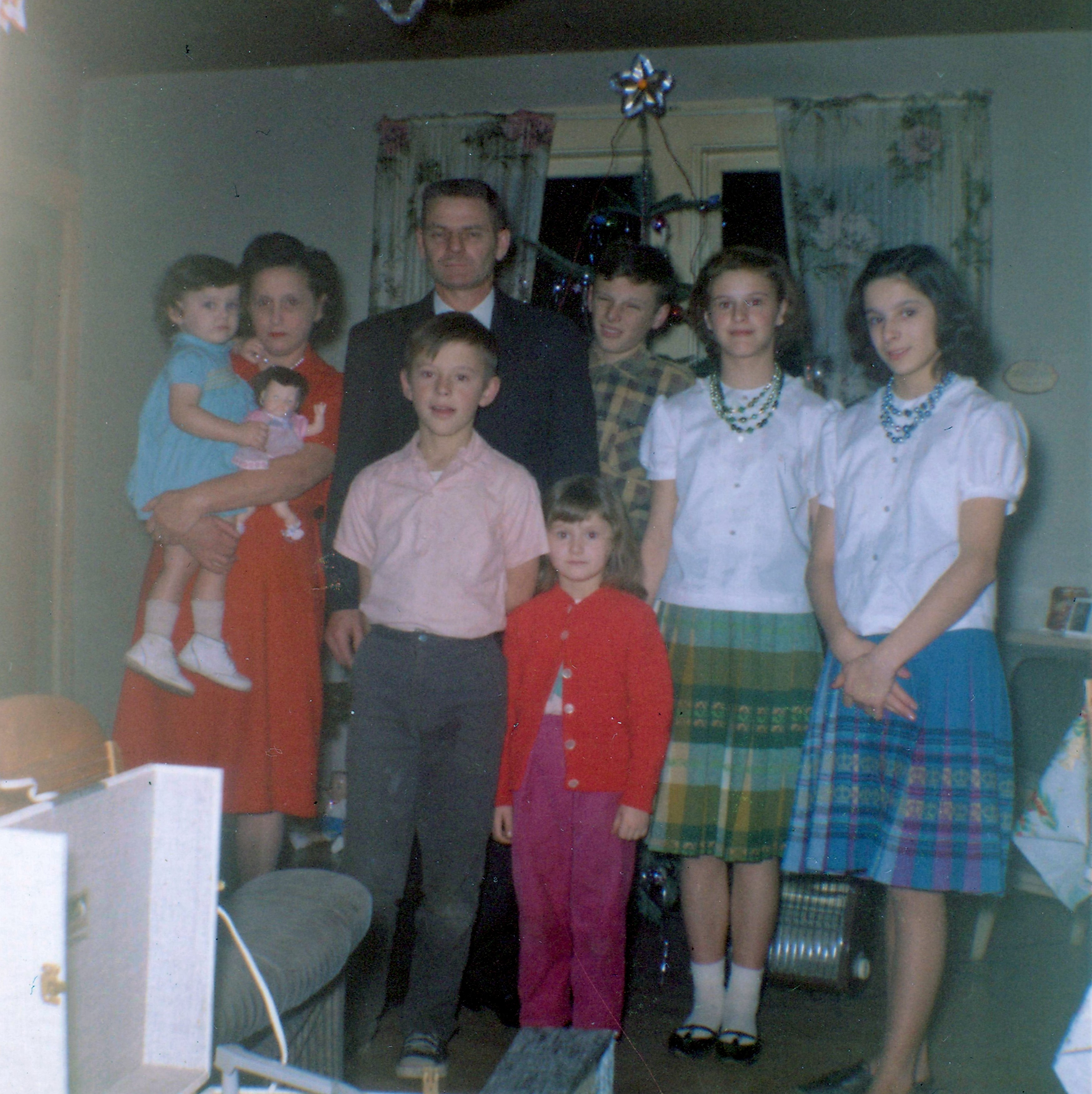 Christmas 1963, Ernie Frazer with his wife and six of his seven children. L to R, Karen Frazer, Christina Frazer, Ernie Frazer, Gary Frazer (in front of Ernie), Teresa Frazer, Donald Frazer (behind Teresa), Linda Frazer, and Dianne Frazer. Eldest daughter Sharon was taking the photo.